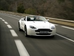aston-martin-v8-vantage-roadster-2009-white-driving-view.jpg