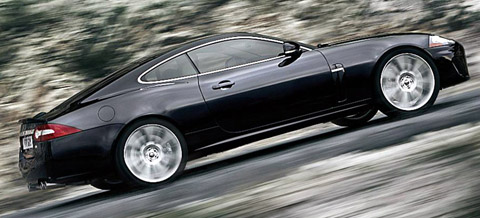 2010 Jaguar XKR black driving up hill