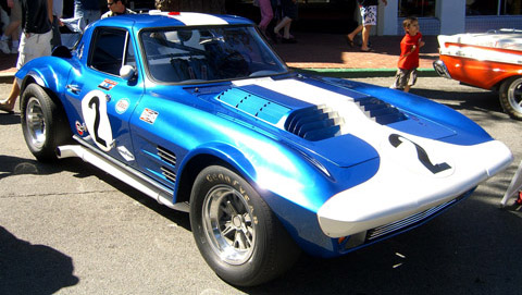 1963 Chevrolet Corvette Grand Sport driven by Bob Bondurant in a race
