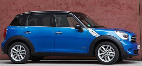 2013-Mini-Countryman-Cooper-ALL4-against-a-red-wall B