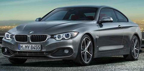 2014-BMW-4-Series-Coupe-above-city-lights A