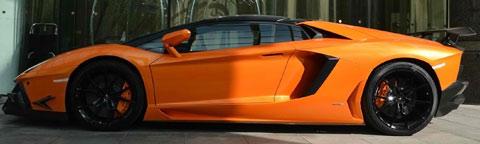2013-DMC-Lamborghini-Aventador-Roadster-SV-checking-in-B